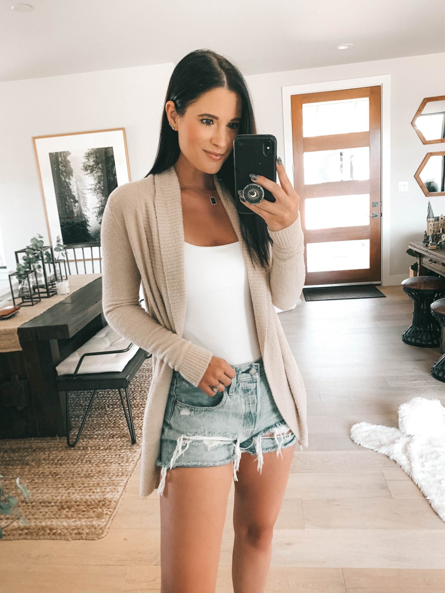 Nordstrom Anniversary Sale by popular Austin fashion blog, Dressed to Kill: image of a woman wearing a white tank, cutoff denim shorts, and a tan cardigan.