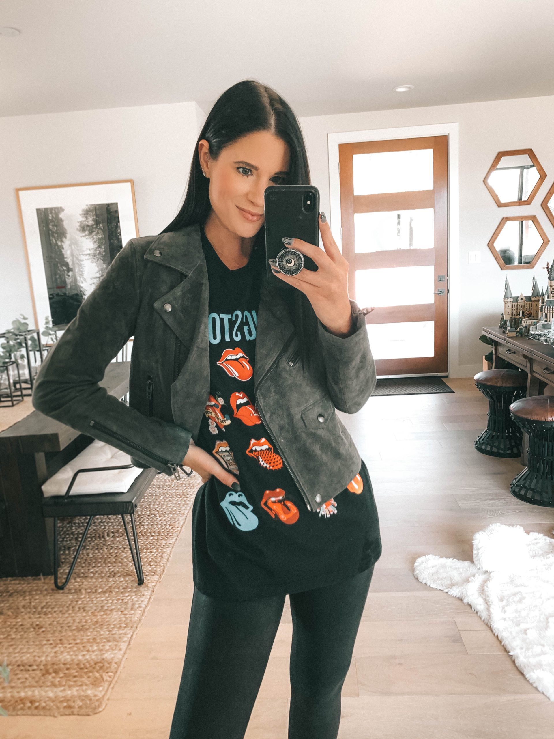 Nordstrom Anniversary Sale by popular Austin fashion blog, Dressed to Kill: image of a woman wearing a Nordstrom Vital Signs Suede Moto Jacket BLANKNYC, Rolling Stones t-shirt, and Nordstrom Faux Leather Leggings SPANX.