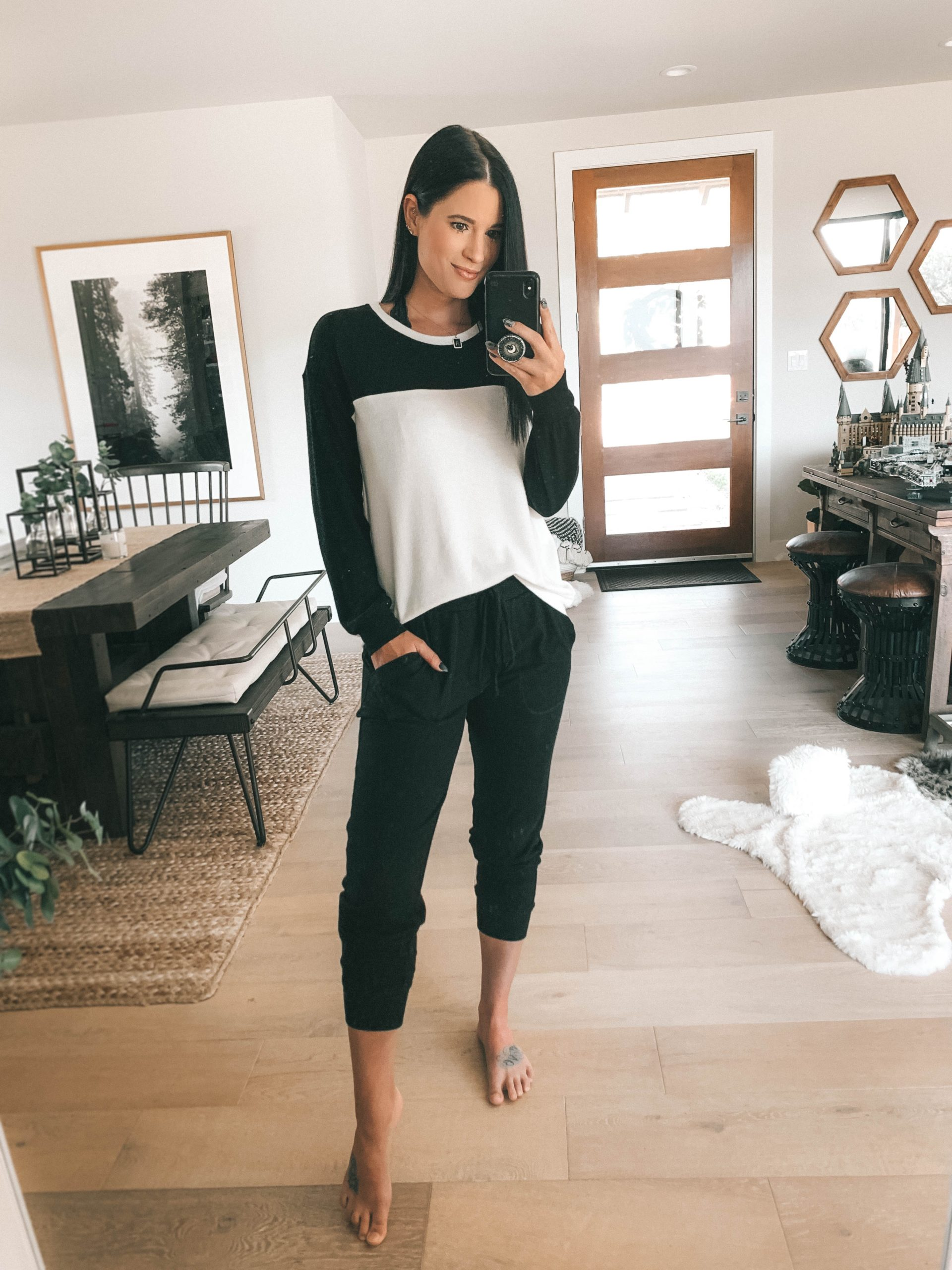 Nordstrom Anniversary Sale by popular Austin fashion blog, Dressed to Kill: image of a woman wearing a Nordstrom Colorblock Cozy Pullover GIBSON and Nordstrom x Living in Yellow Skye Cozy Jogger Pants GIBSON.