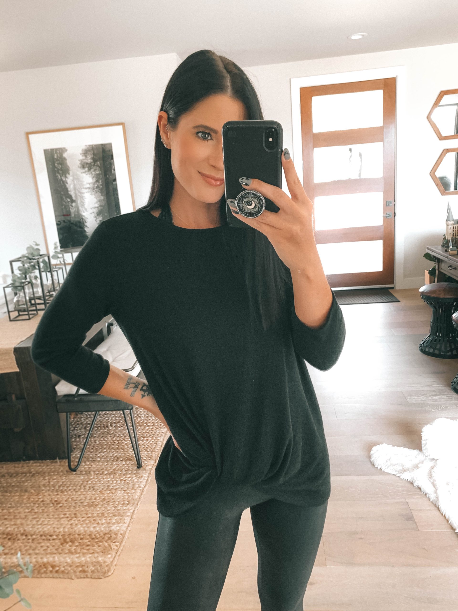 Nordstrom Anniversary Sale by popular Austin fashion blog, Dressed to Kill: image of a woman wearing a Nordstrom Cozy Twist Front Pullover GIBSON and Nordstrom Faux Leather Leggings SPANX.