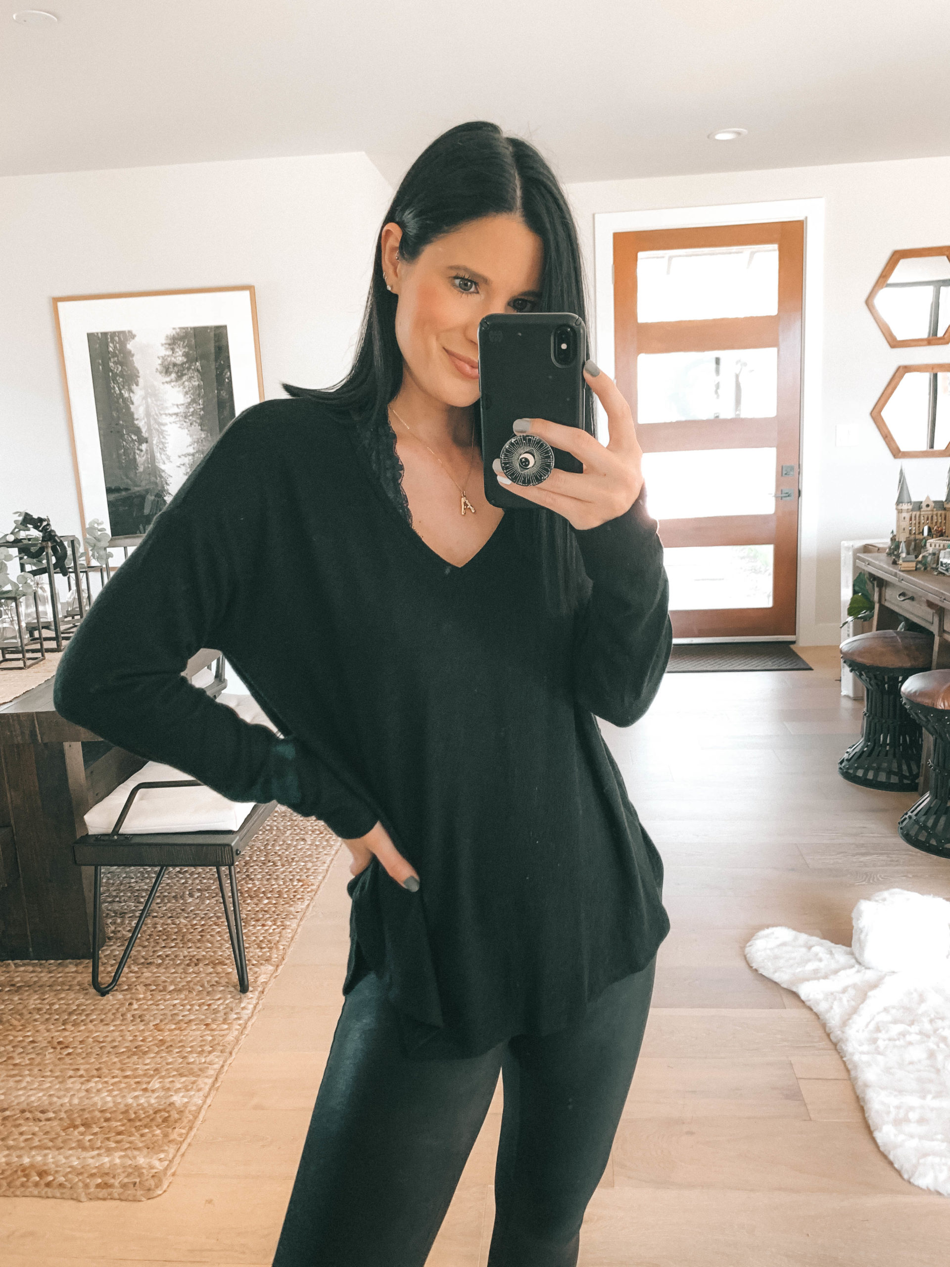 Nordstrom Anniversary Sale by popular Austin fashion blog, Dressed to Kill: image of a woman wearing a Nordstrom Cozy V-Neck Tunic GIBSON and Nordstrom Faux Leather Leggings SPANX.