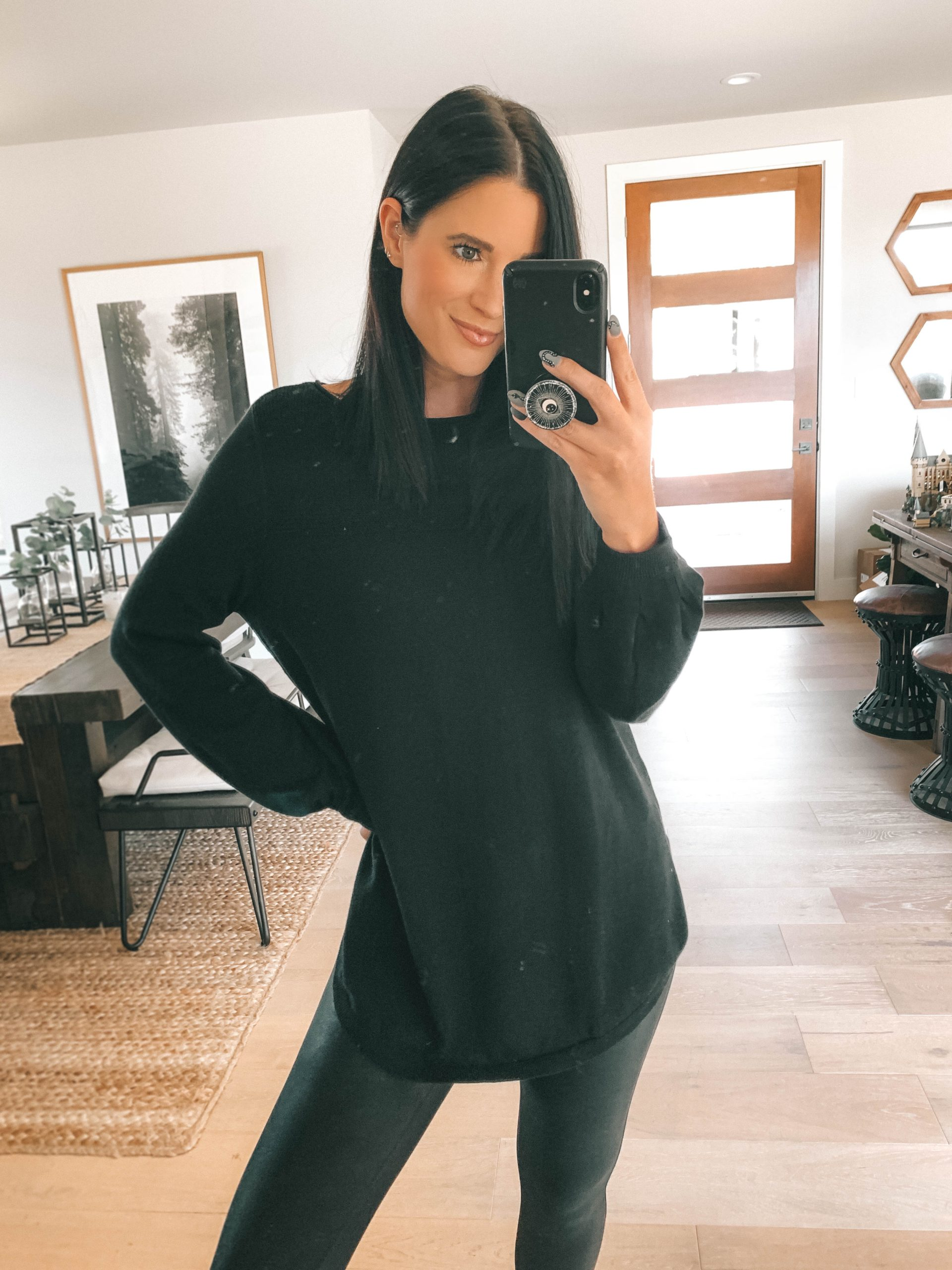 Nordstrom Anniversary Sale by popular Austin fashion blog, Dressed to Kill: image of a woman wearing Nordstrom Faux Leather Leggings SPANX, Nordstrom UltraBoost Running Shoe ADIDAS, and Nordstrom Bishop Sleeve Sweater CASLON.