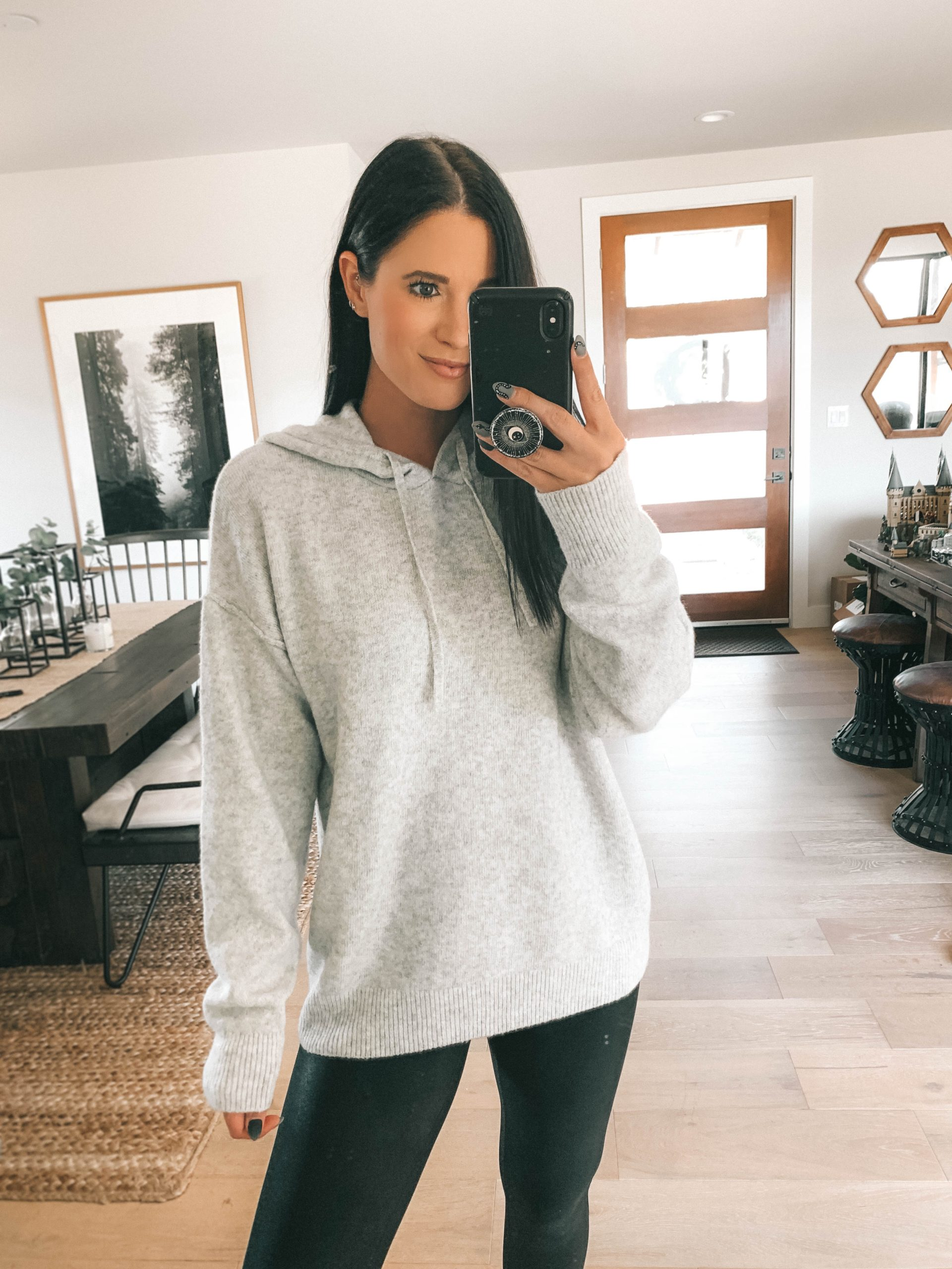 Nordstrom Anniversary Sale by popular Austin fashion blog, Dressed to Kill: image of a woman wearing a Nordstrom Faux Leather Leggings SPANX and Nordstrom Cotton Blend Sweater Hoodie TREASURE & BOND.