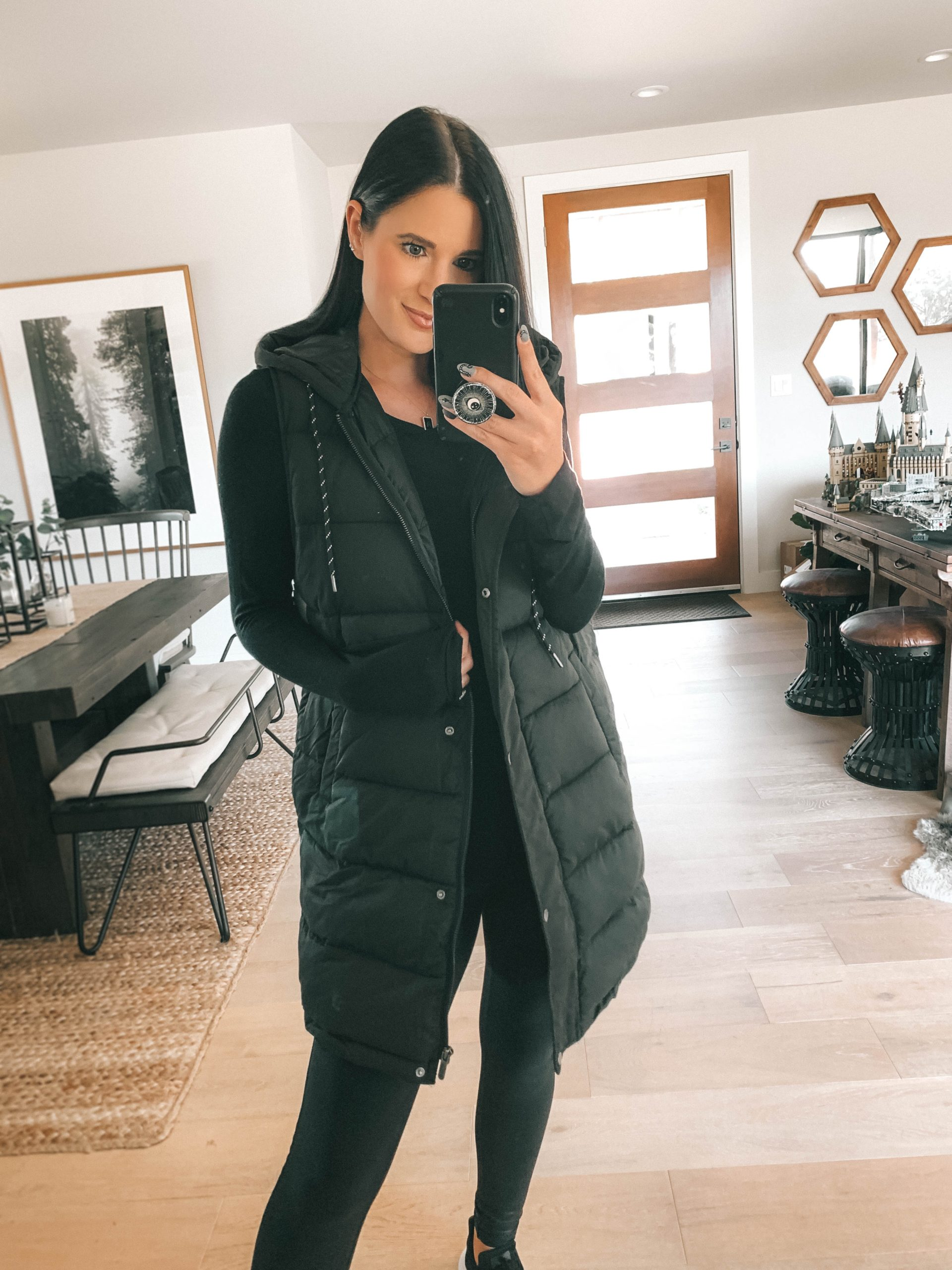 Nordstrom Anniversary Sale by popular Austin fashion blog, Dressed to Kill: image of a woman wearing Nordstrom Faux Leather Leggings SPANX, Nordstrom Layering Tee CHELSEA28, and Nordstrom Long Hooded Puffer Vest ZELLA.