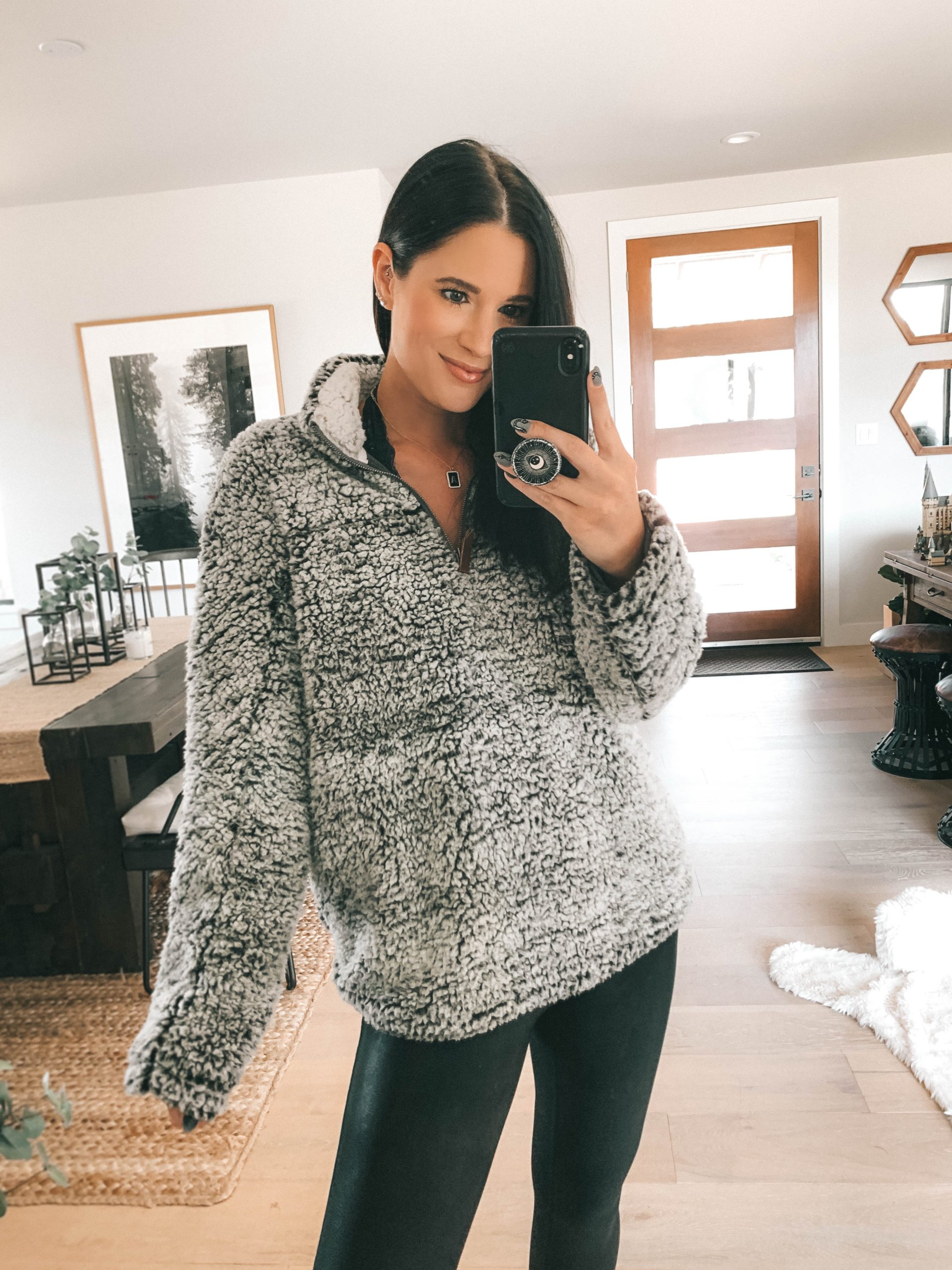 Nordstrom Anniversary Sale by popular Austin fashion blog, Dressed to Kill: image of a woman wearing a Nordstrom Wubby Fleece Pullover THREAD & SUPPLY and Nordstrom Faux Leather Leggings SPANX.
