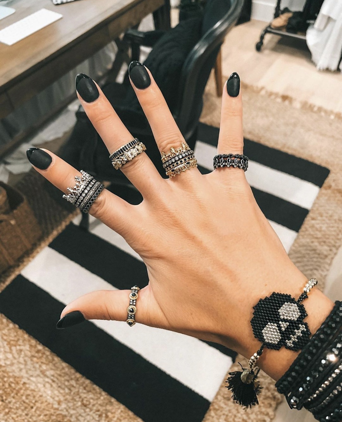 Nail Art Designs by popular Austin beauty blog, Dressed to Kill: image of a woman with black matte nail art.