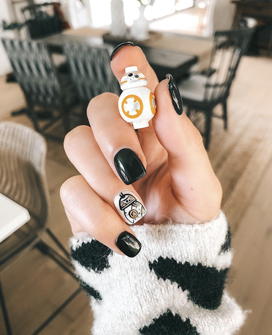 Nail Art Designs by popular Austin beauty blog, Dressed to Kill: image of a woman with Star Wars nail art.
