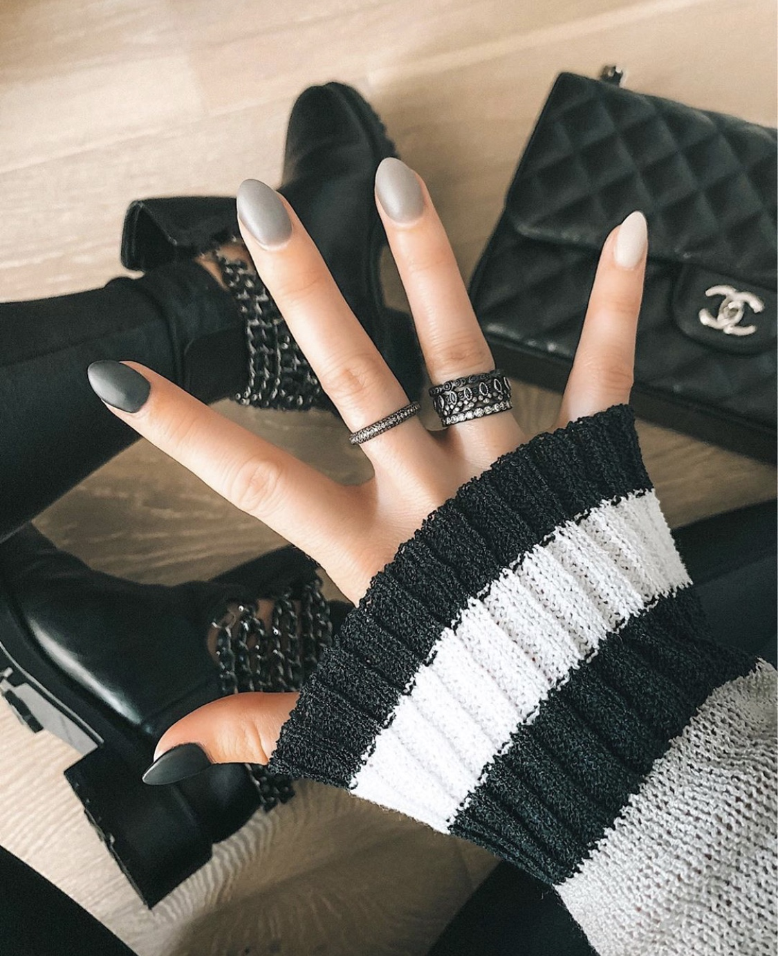 Nail Art Designs by popular Austin beauty blog, Dressed to Kill: image of a woman with grey ombre nail art.