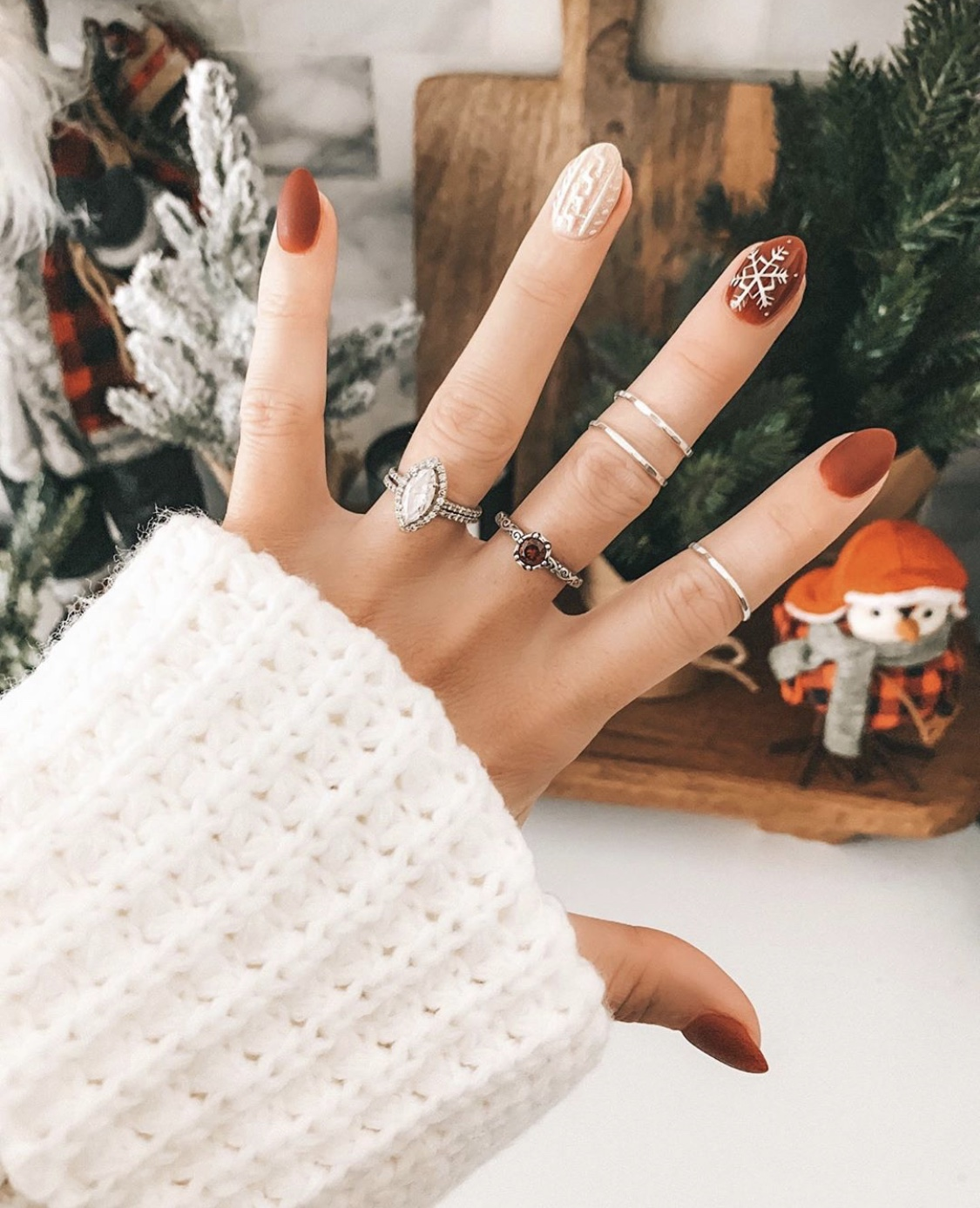 Nail Art Designs by popular Austin beauty blog, Dressed to Kill: image of a woman with holiday nail are and wearing a James Avery ruby ring and James Avery hammer silver rings.