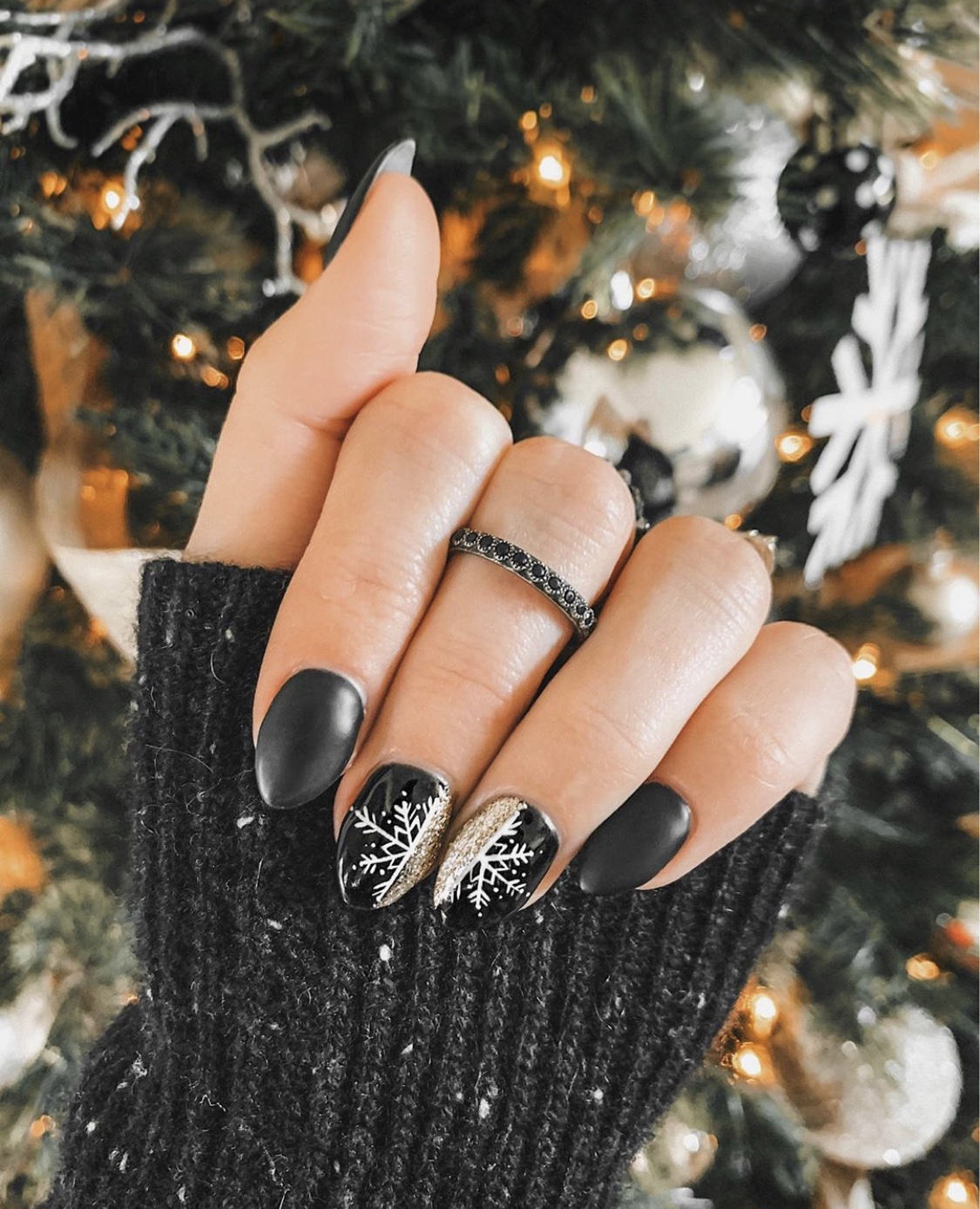 Nail Art Designs by popular Austin beauty blog, Dressed to Kill: image of a woman with nail art and wearing a Armenta ring.