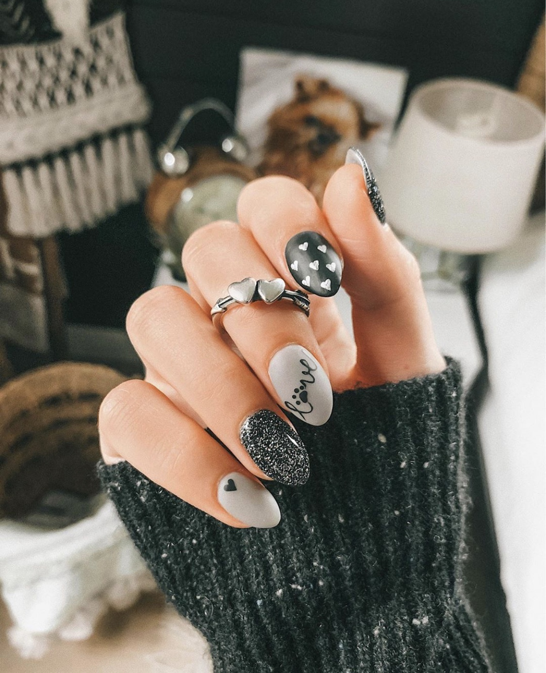 Nail Art Designs by popular Austin beauty blog, Dressed to Kill: image of a woman with black and grey animal nail art and wearing a James Avery silver heart ring.