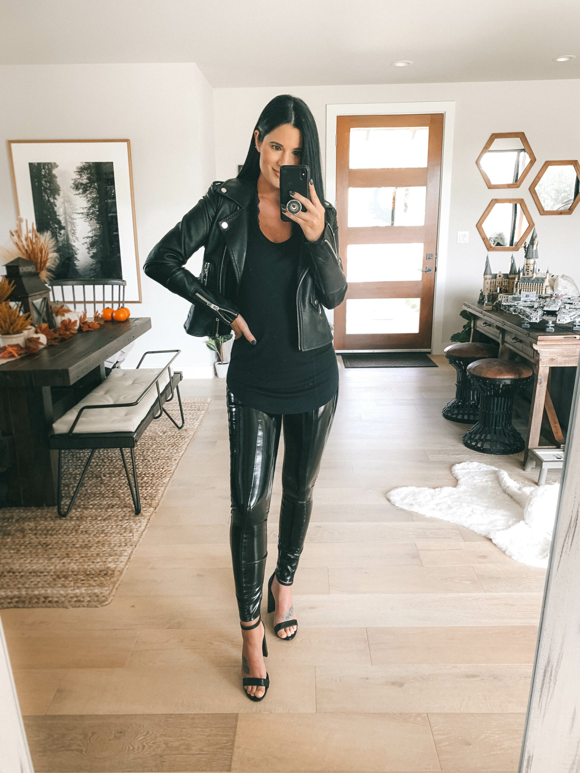 Patent Leather Leggings by popular Austin fashion blog, Dressed to Kill: image of a woman wearing a pair of Spanx Faux Patent Leather Leggings with black block heel sandals, a black leather jacket, and a black t-shirt.