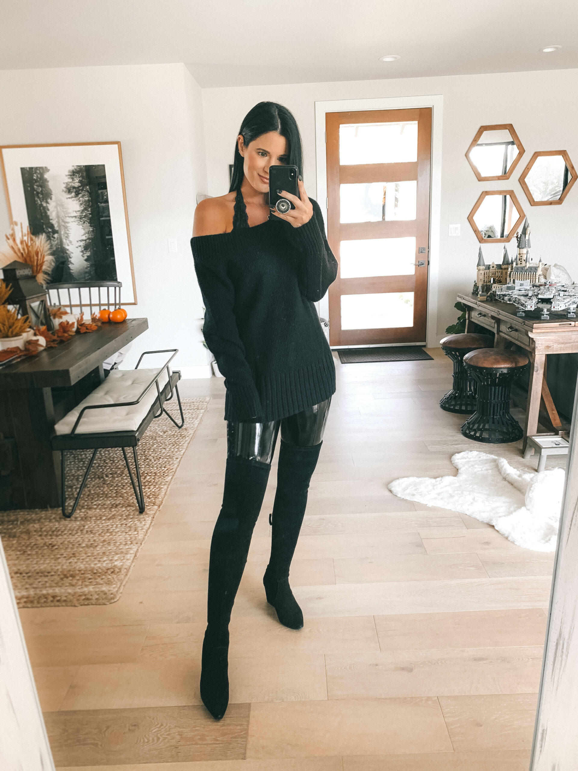 Patent Leather Leggings by popular Austin fashion blog, Dressed to Kill: image of a woman wearing a pair of Spanx Faux Patent Leather Leggings with over-the-knee black suede boots, black off the shoulder sweater, and a black lace bralette.