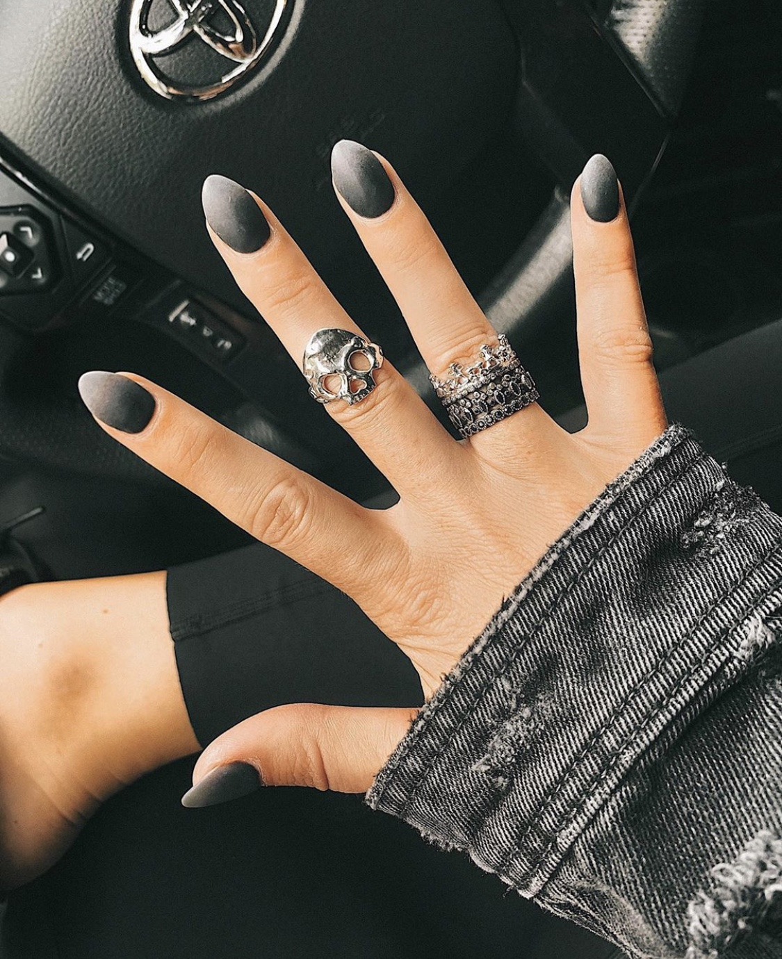 Nail Art Designs by popular Austin beauty blog, Dressed to Kill: image of a woman with black ombre nail art.