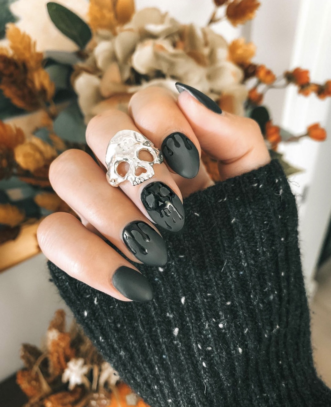 Nail Art Designs by popular Austin beauty blog, Dressed to Kill: image of a woman with Halloween nail art and wearing a Margaret Cross skull ring.