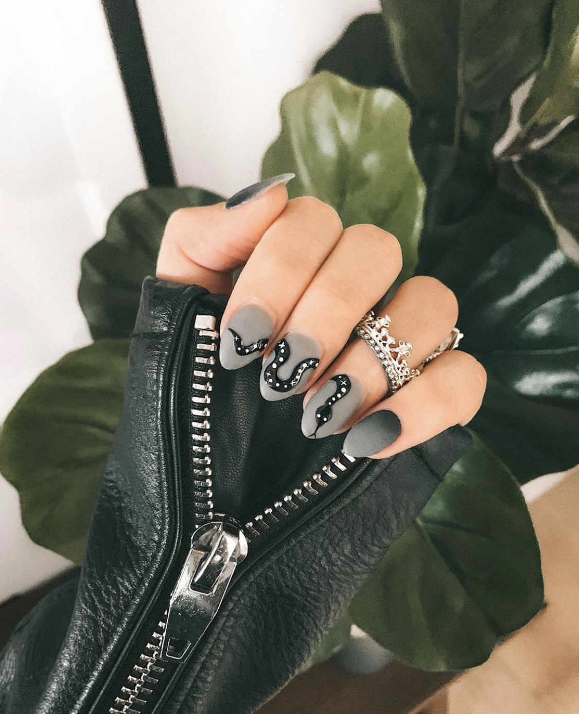 Nail Art Designs by popular Austin beauty blog, Dressed to Kill: image of a woman with grey and black snack design nail art and wearing a Armenta ring.