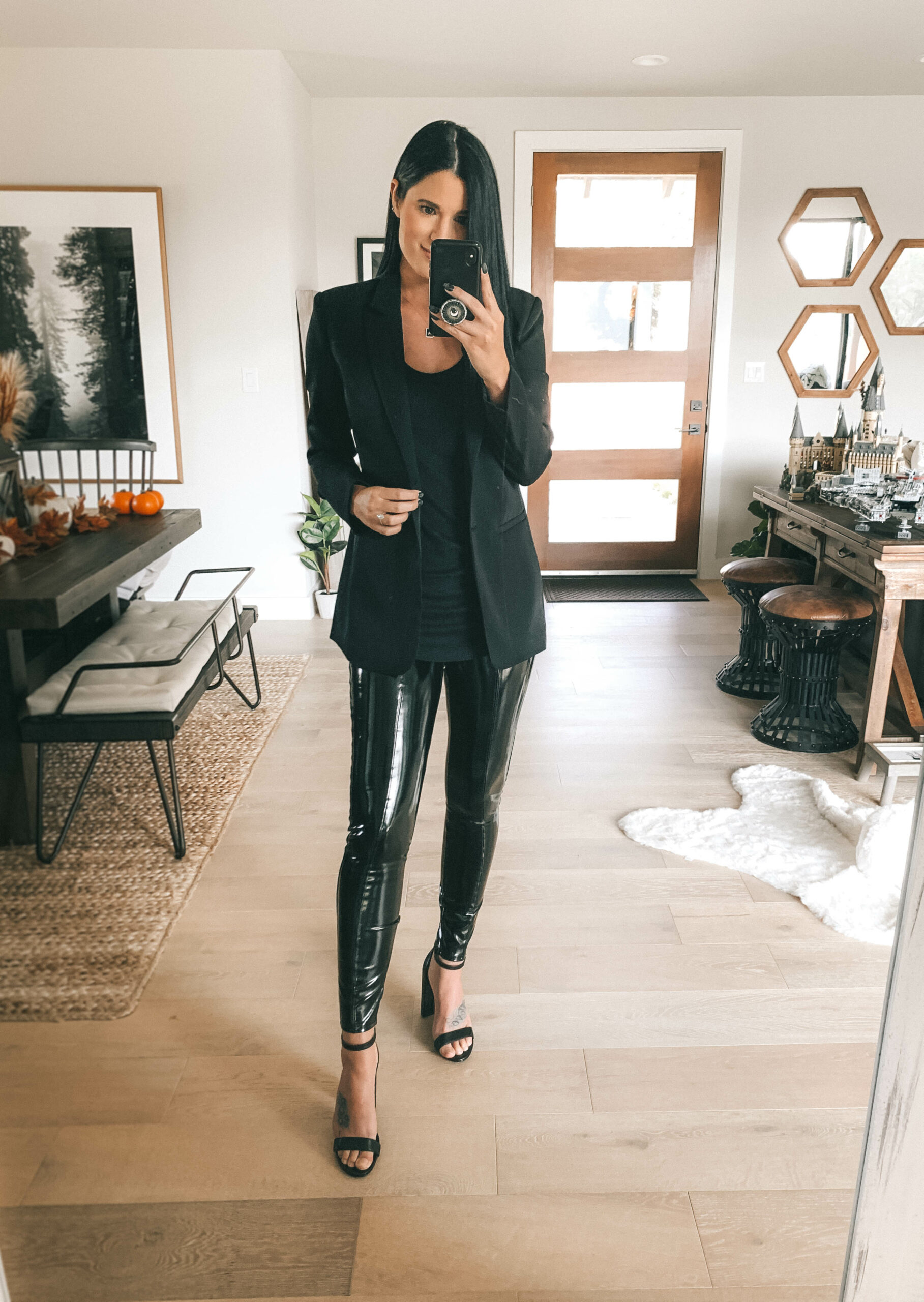 Patent Leather Leggings by popular Austin fashion blog, Dressed to Kill: image of a woman wearing a pair of Spanx Faux Patent Leather Leggings with black block heel sandals, a black blazer, and a black t-shirt.