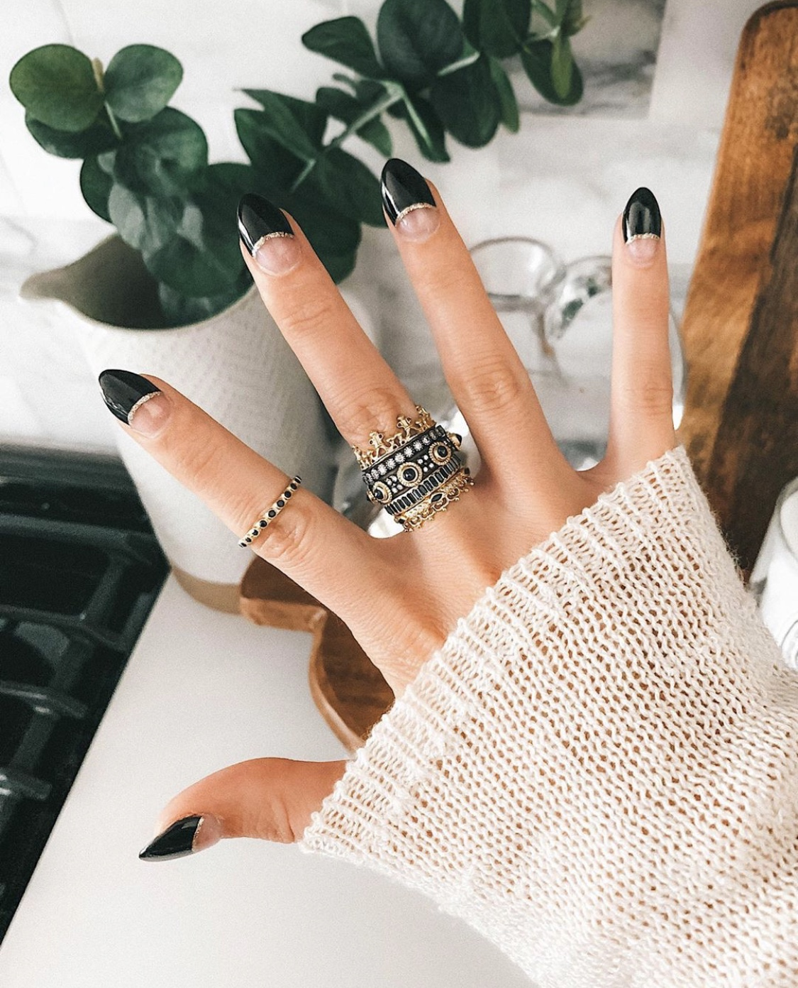 Nail Art Designs by popular Austin beauty blog, Dressed to Kill: image of a woman with black, gold and clear nail art.