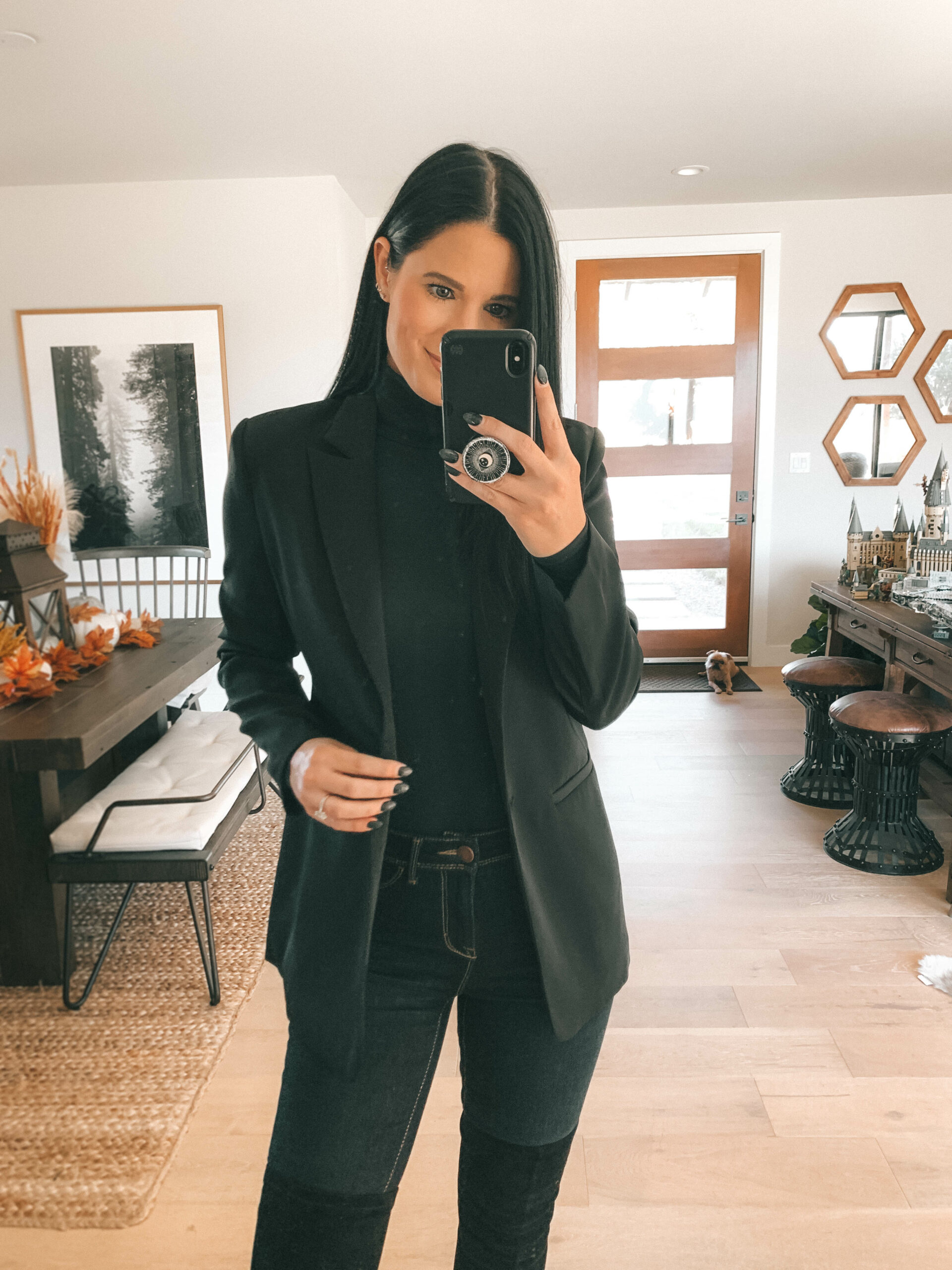 Spanx Bodysuit by popular Austin fashion blog, Dressed to Kill: image of a woman wearing a black long sleeve Spanx bodysuit with a black blazer, jeans, and black over the knee boots.