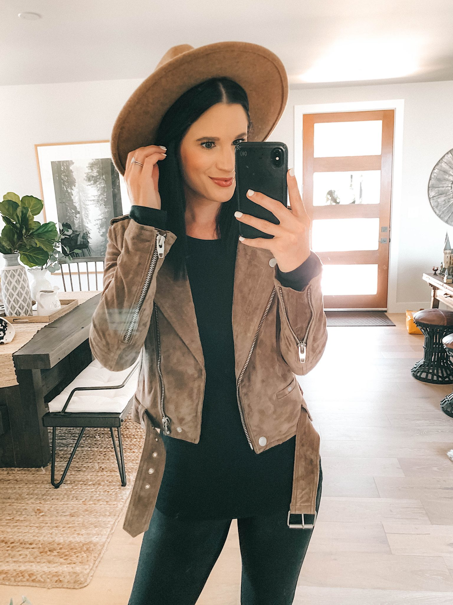 Nordstrom Anniversary Sale by popular Austin fashion blog, Dressed to Kill: image of a woman wearing a brown suede jacket, brown felt fedora, and black long sleeve top.