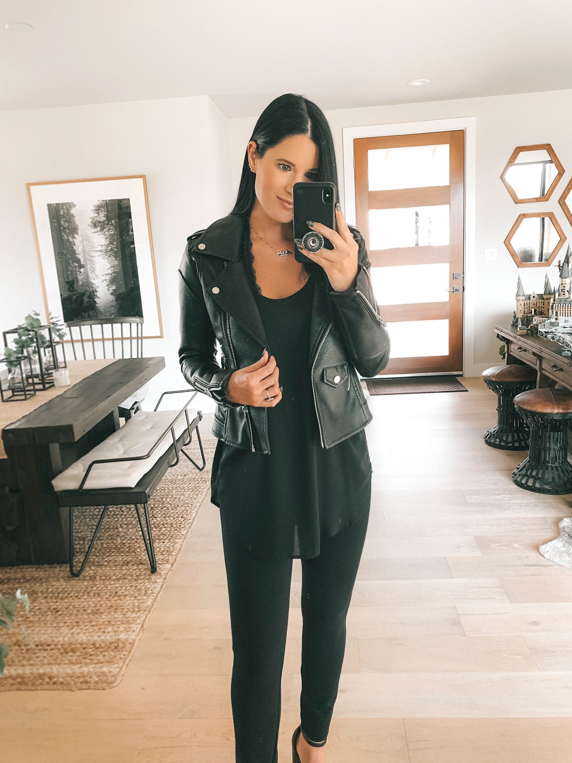 Nordstrom Anniversary Sale by popular Austin fashion blog, Dressed to Kill: image of a woman wearing a black faux leather jacket, black top, and black faux leather leggings.