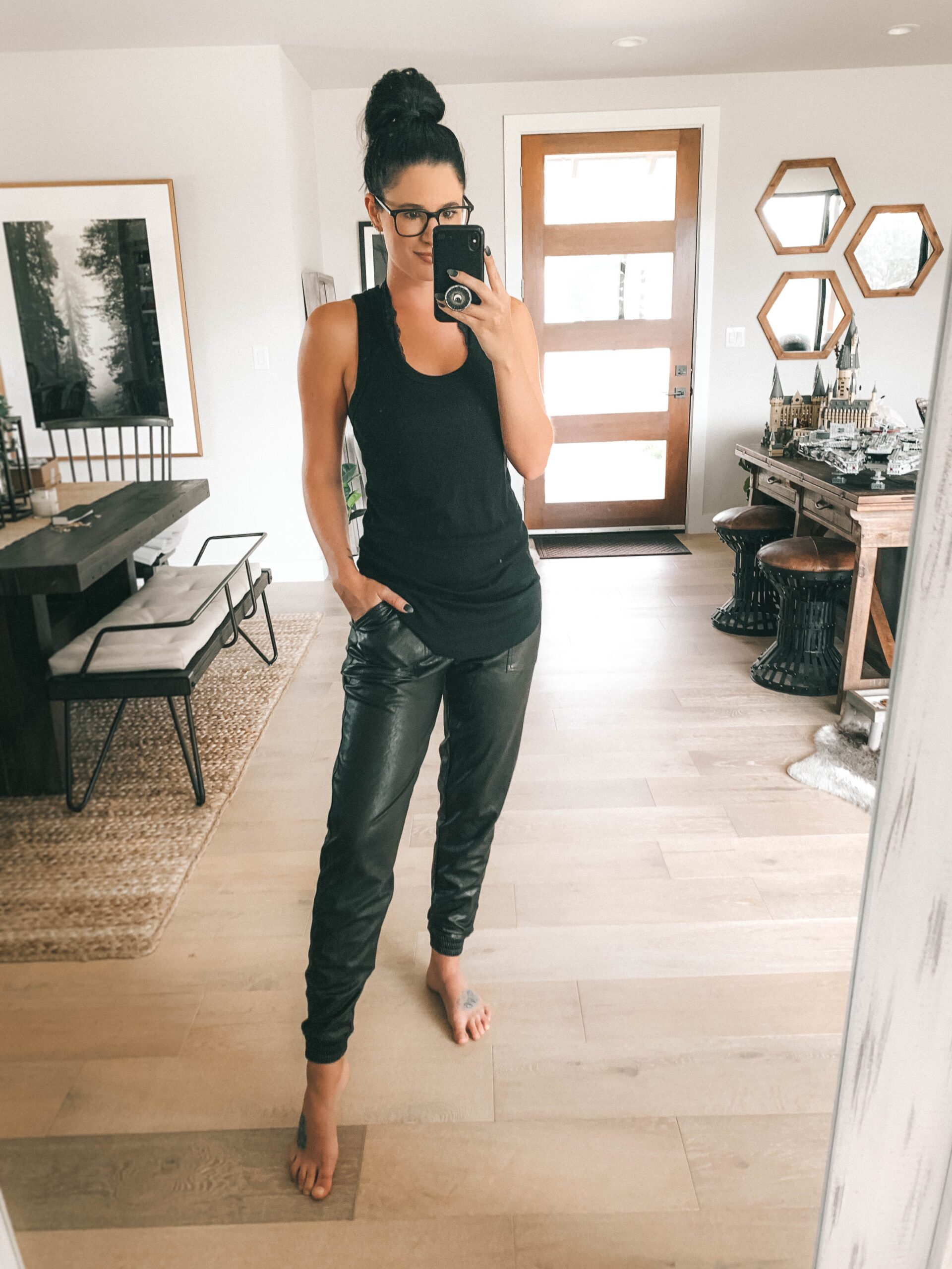 Nordstrom Anniversary Sale by popular Austin fashion blog, Dressed to Kill: image of a woman wearing a black tank top and black faux leather jogger pants.