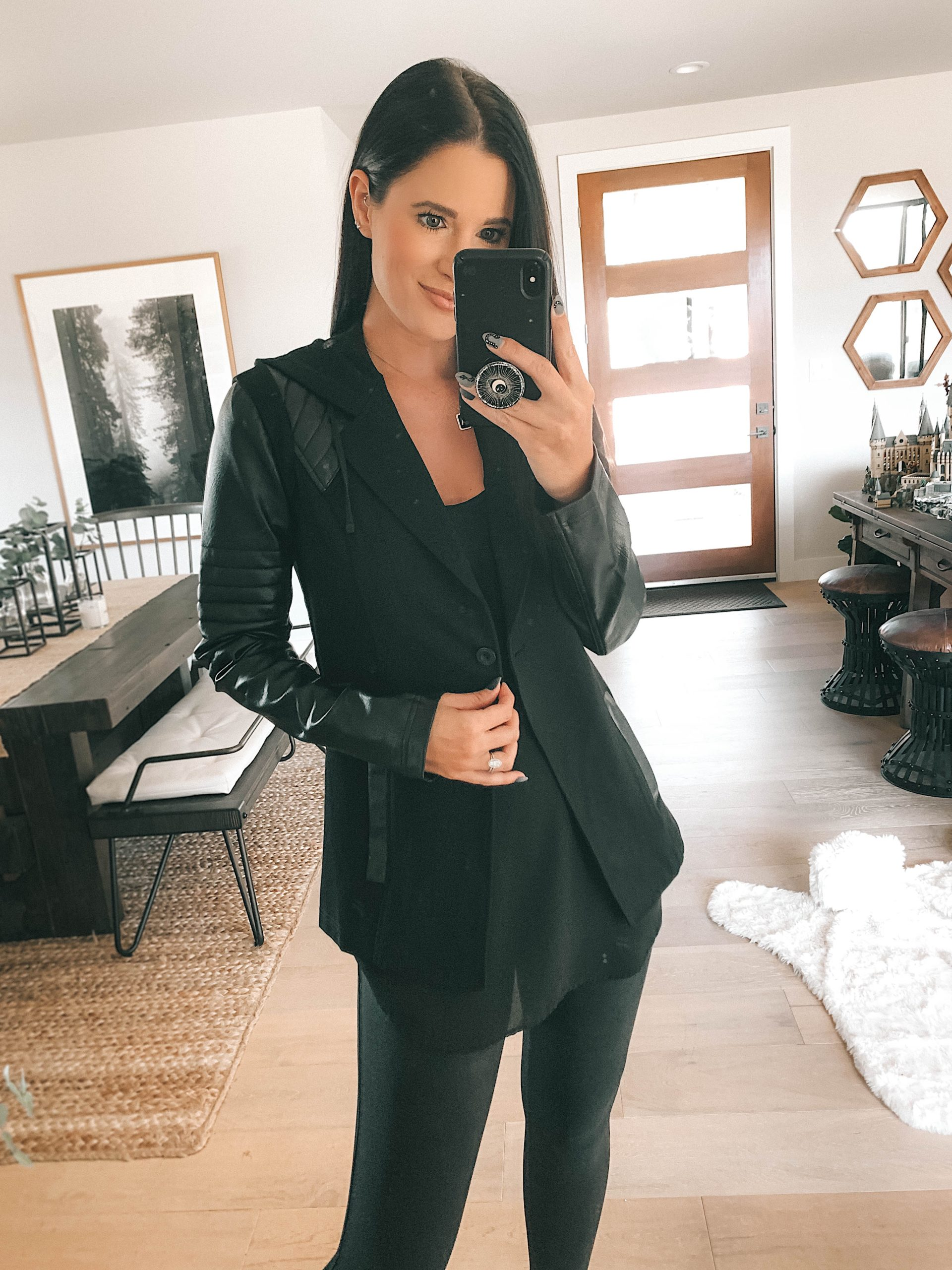 Nordstrom Anniversary Sale by popular Austin fashion blog, Dressed to Kill: image of a woman wearing a black jacket, black top and black faux leather leggings.