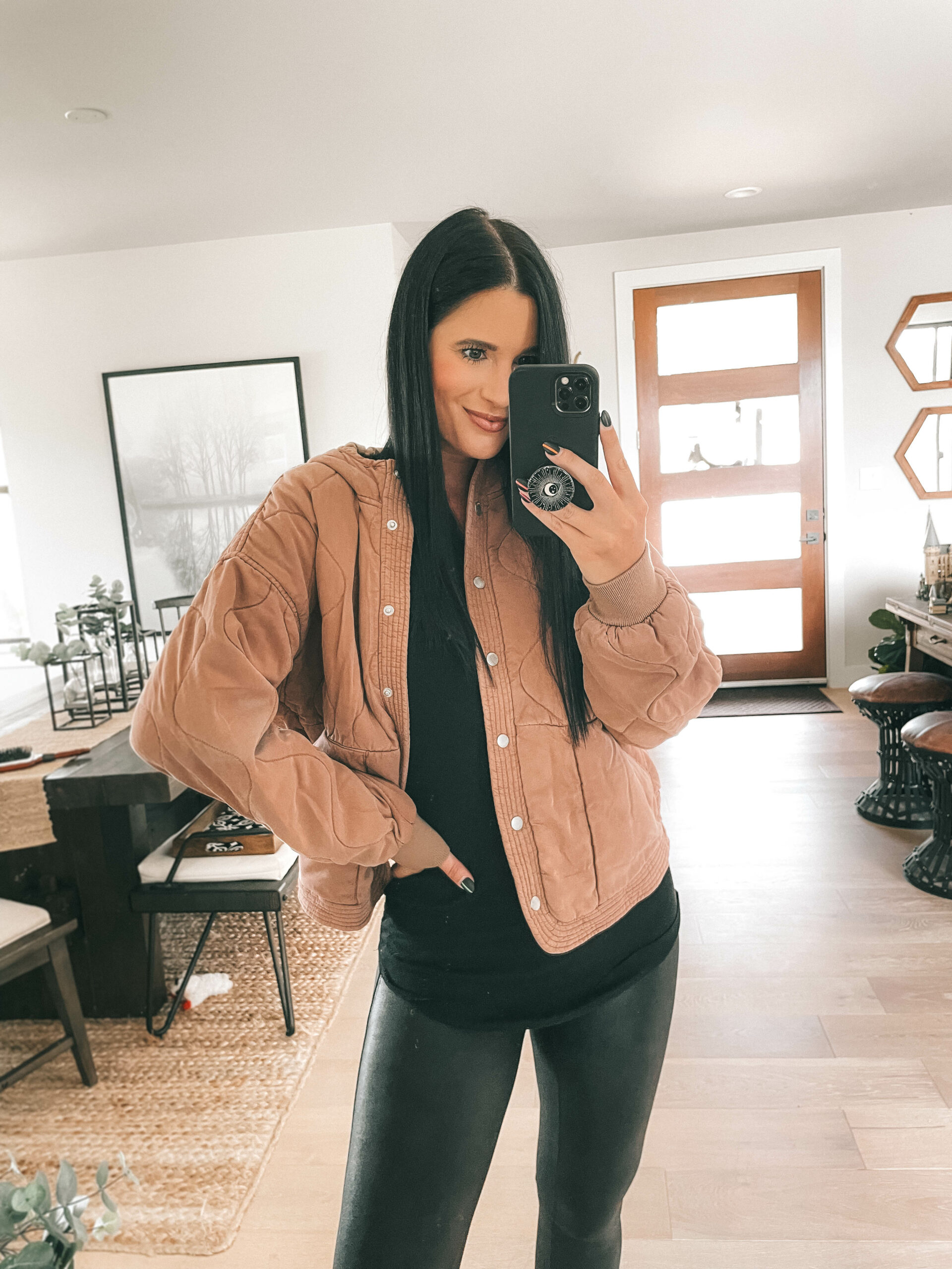 Nordstrom Anniversary Sale by popular Austin fashion blog, Dressed to Kill: image of a woman wearing a brown quilted jacket, black top, and black faux leather leggings.
