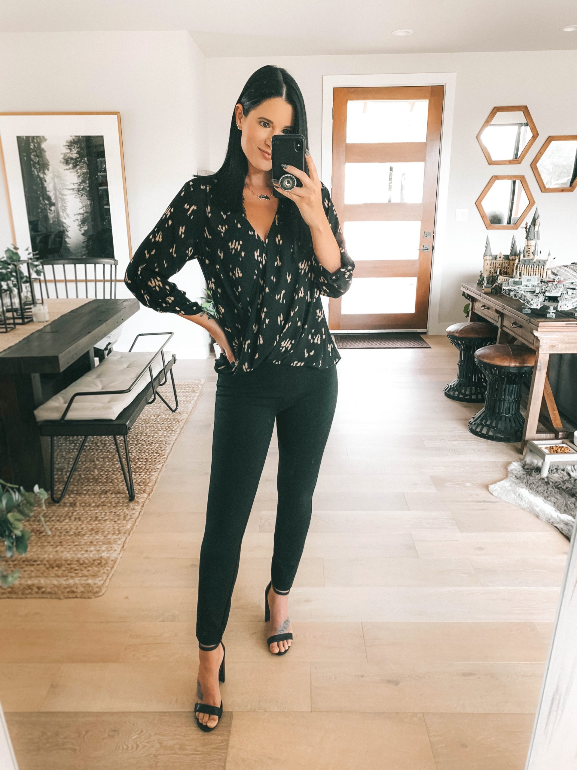 Nordstrom Anniversary Sale by popular Austin fashion blog, Dressed to Kill: image of a woman wearing a black long sleeve blouse, black faux leather leggings, and black block heel sandals.