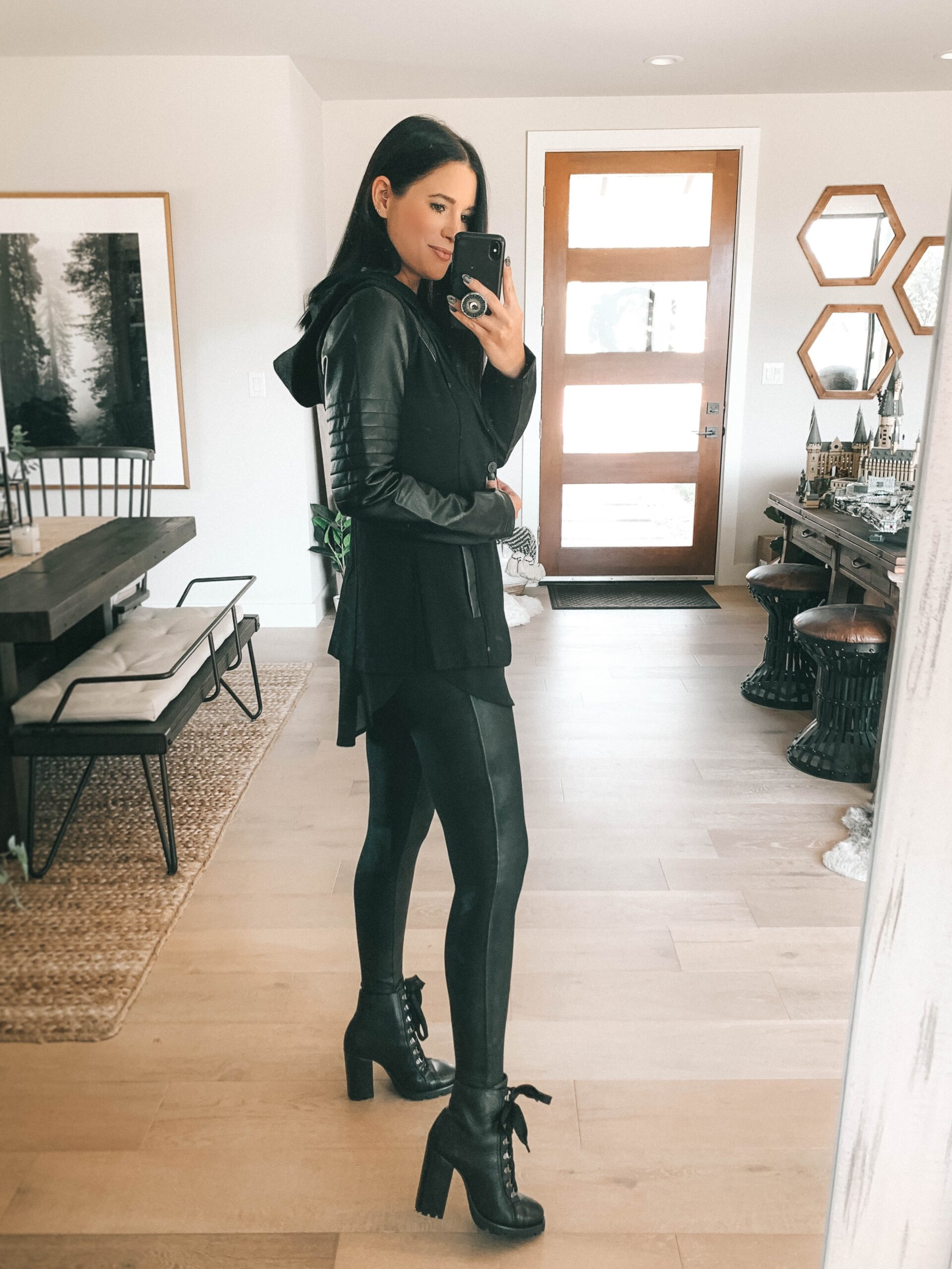 Nordstrom Anniversary Sale by popular Austin fashion blog, Dressed to Kill: image of a woman wearing a black jacket, black top, black faux leather leggings, and black block heel combat boots.