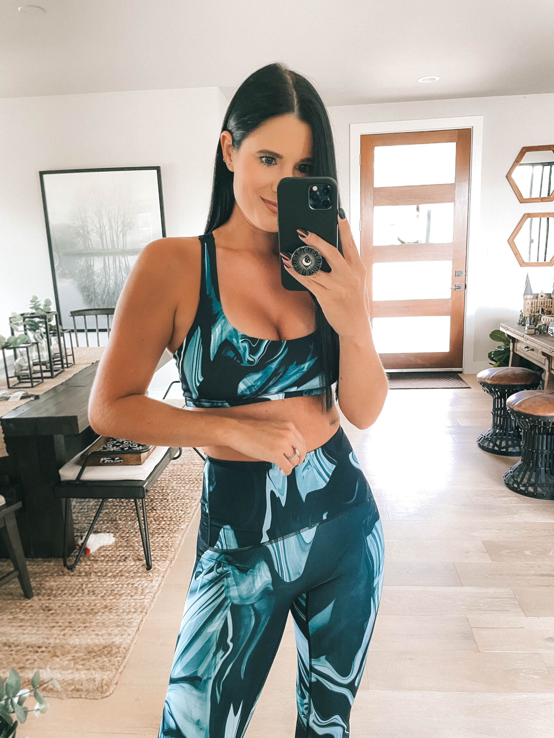 Nordstrom Anniversary Sale by popular Austin fashion blog, Dressed to Kill: image of a woman wearing a blue and black sports bra and matching blue and black leggings.