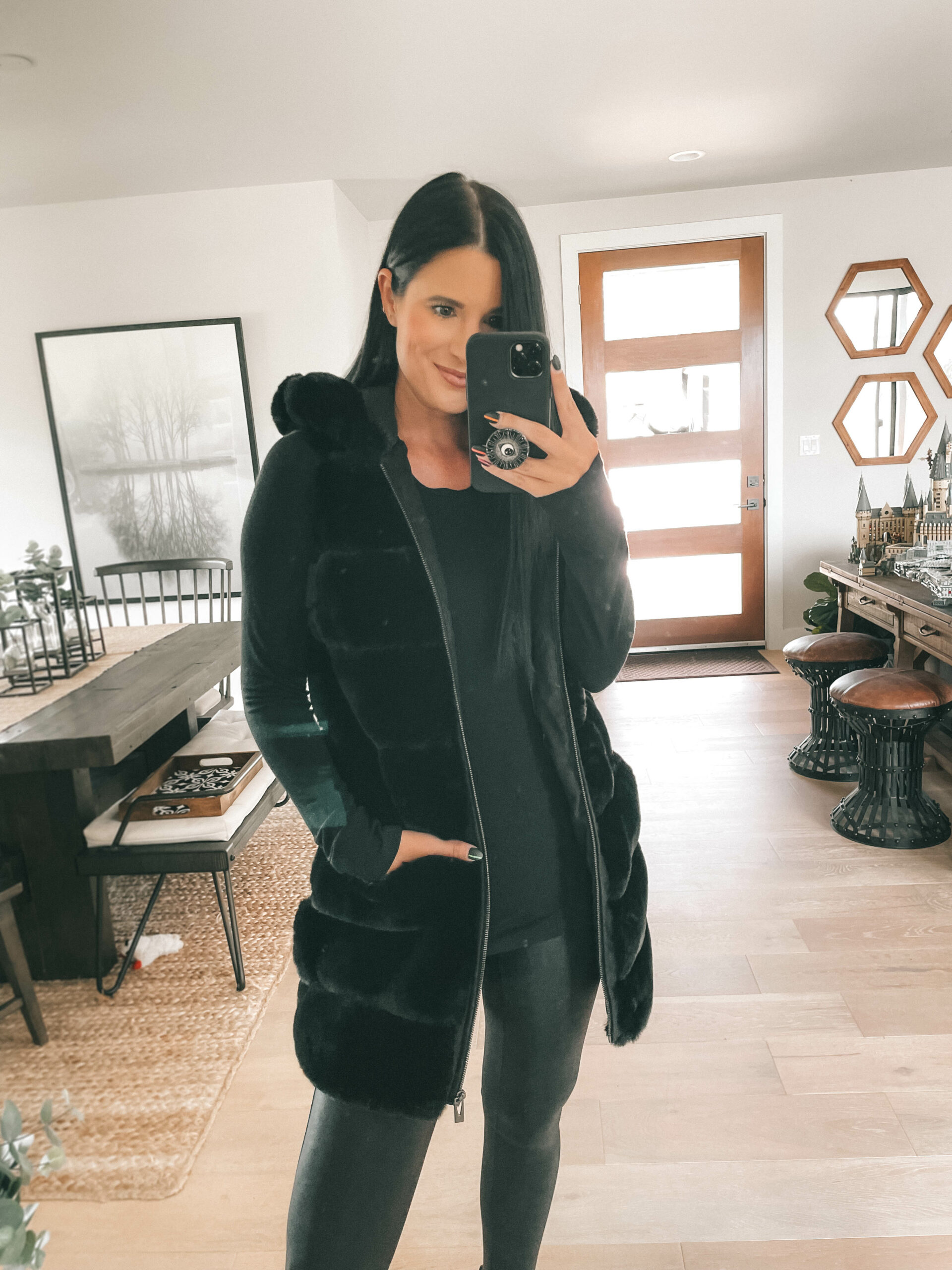 Nordstrom Anniversary Sale by popular Austin fashion blog, Dressed to Kill: image of a woman wearing a black puffer jacket, black top, and black faux leather leggings.