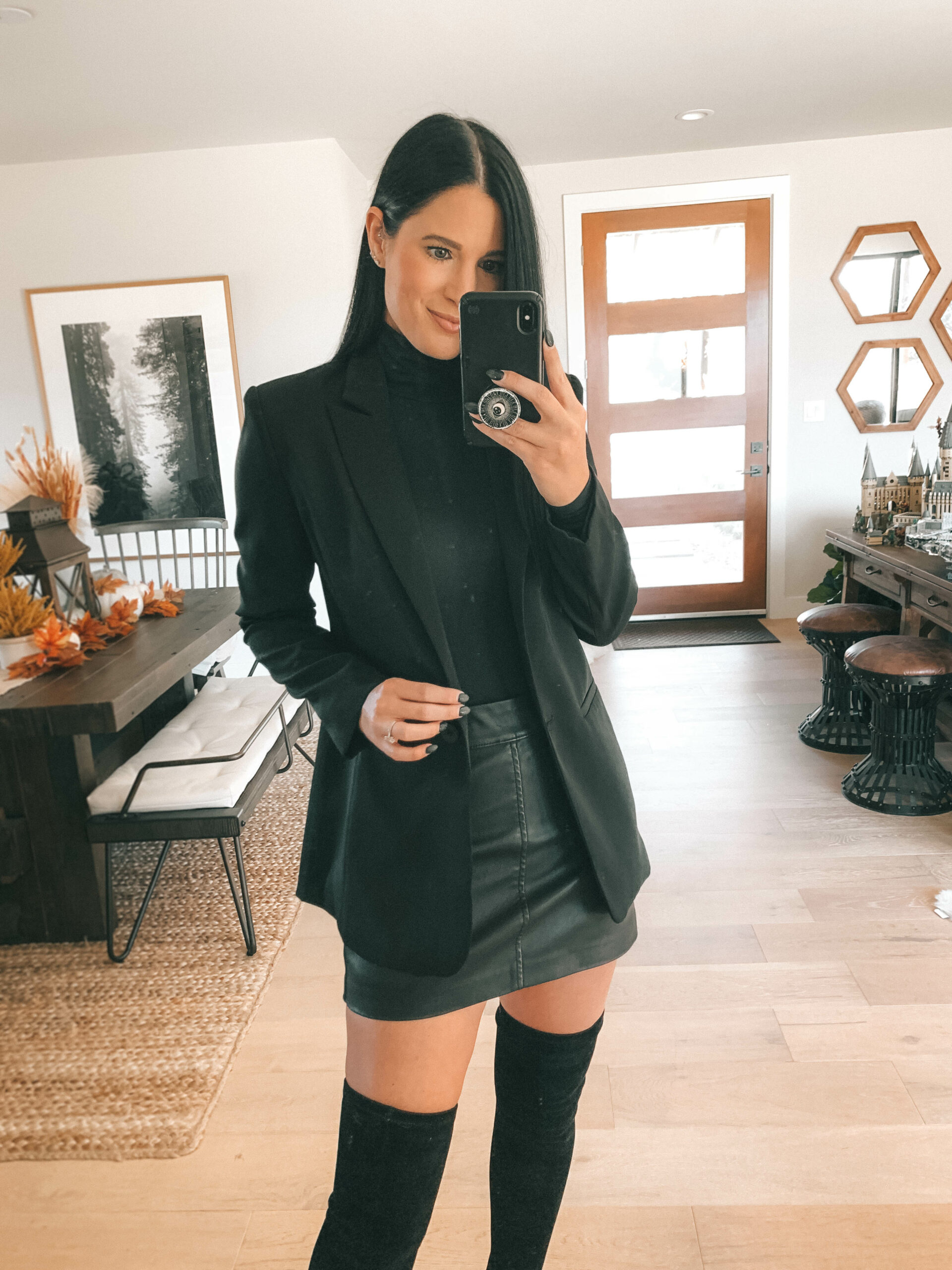 Spanx Bodysuit by popular Austin fashion blog, Dressed to Kill: image of a woman wearing a black long sleeve Spanx bodysuit with a black blazer, black faux leather mini skirt, and black over the knee boots.